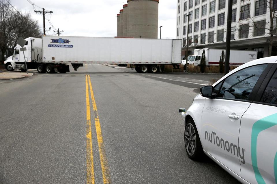 South Boston, MA -- 1/4/2017 - NuTonomy's driverless car pauses as a truck pulls out as it takes a spin around Drydock Ave. (Jessica Rinaldi/Globe Staff) Topic: 05driverlesscar Reporter: