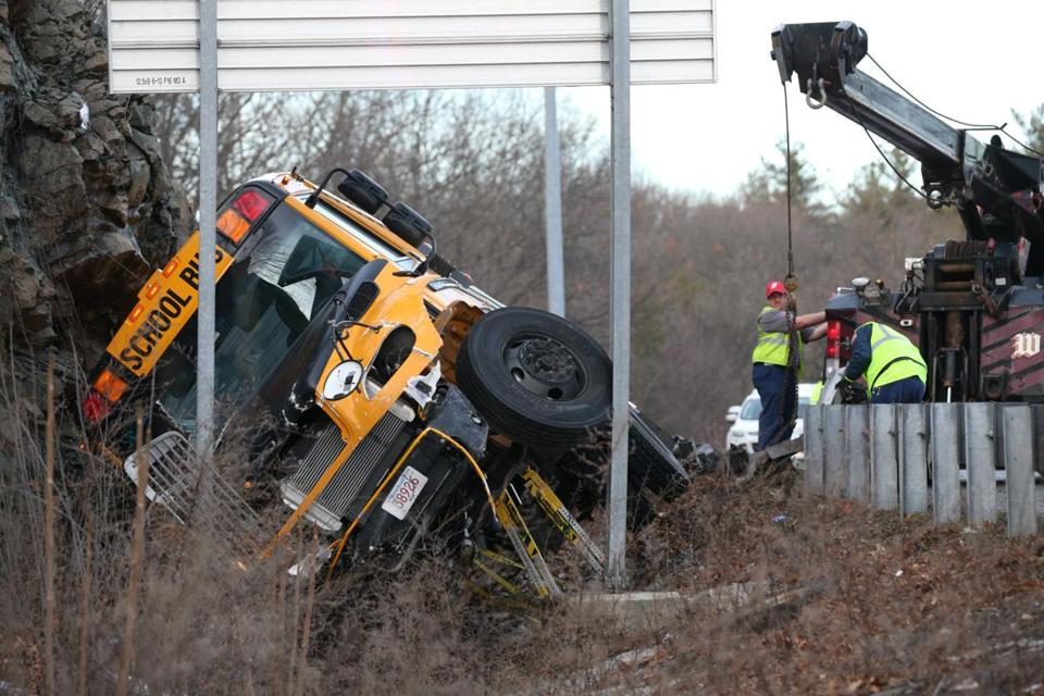 Waltham, MA - January 11, 2017: A school bus rolled over a guardrail Wednesday afternoon on Interstate 95 in Waltham while carrying students from Ephraim Curtis Middle School in Sudbury, according to State Police. in Waltham, MA on January 11, 2017. (Globe staff photo / Craig F. Walker) section: Business reporter: