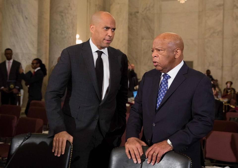 Senator Cory Booker (left) and Representative John Lewis warned the nation could cut back civil rights.