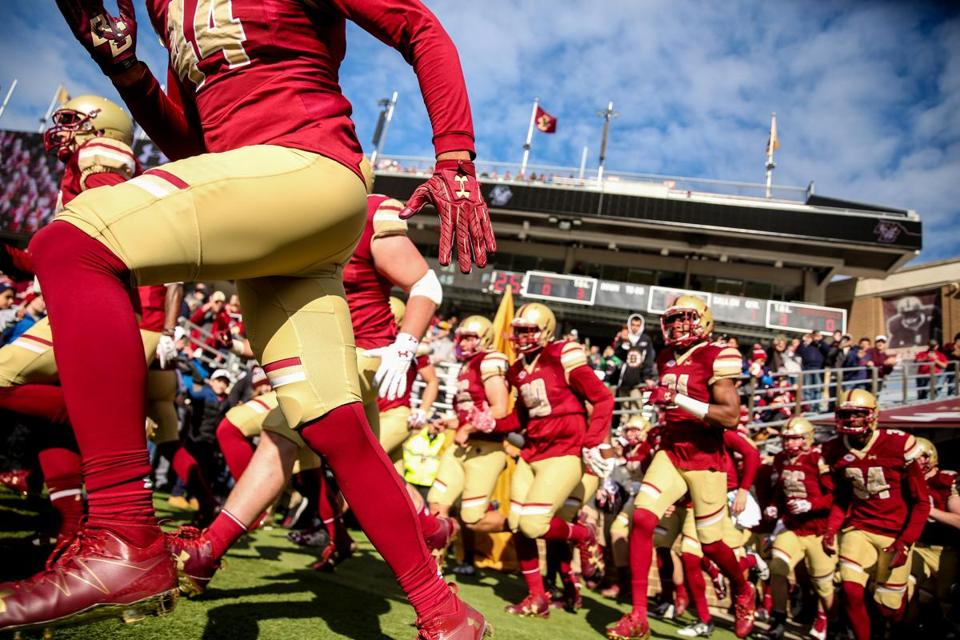 CHESTNUT HILL, MA - NOVEMBER 05: Members of Boston College run onto the field before a game against Louisville at Alumni Stadium on November 5, 2016 in Chestnut Hill, Massachusetts. (Photo by Billie Weiss/Getty Images)