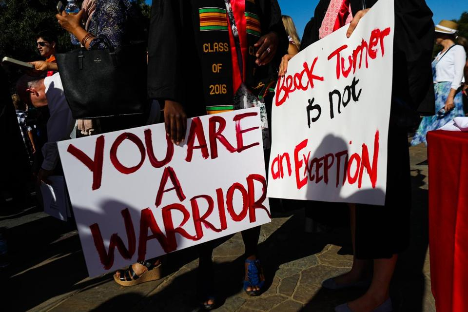 Stanford students carried signs in solidarity for a Stanford rape victim during graduation ceremonies at Stanford University, in Palo Alto, California, on June 12, 2016. Stanford students are protesting the universitys handling of rape cases alledging that the campus keeps secret the names of students found to be responsible for sexual assault and misconduct. / AFP / GABRIELLE LURIE (Photo credit should read GABRIELLE LURIE/AFP/Getty Images)