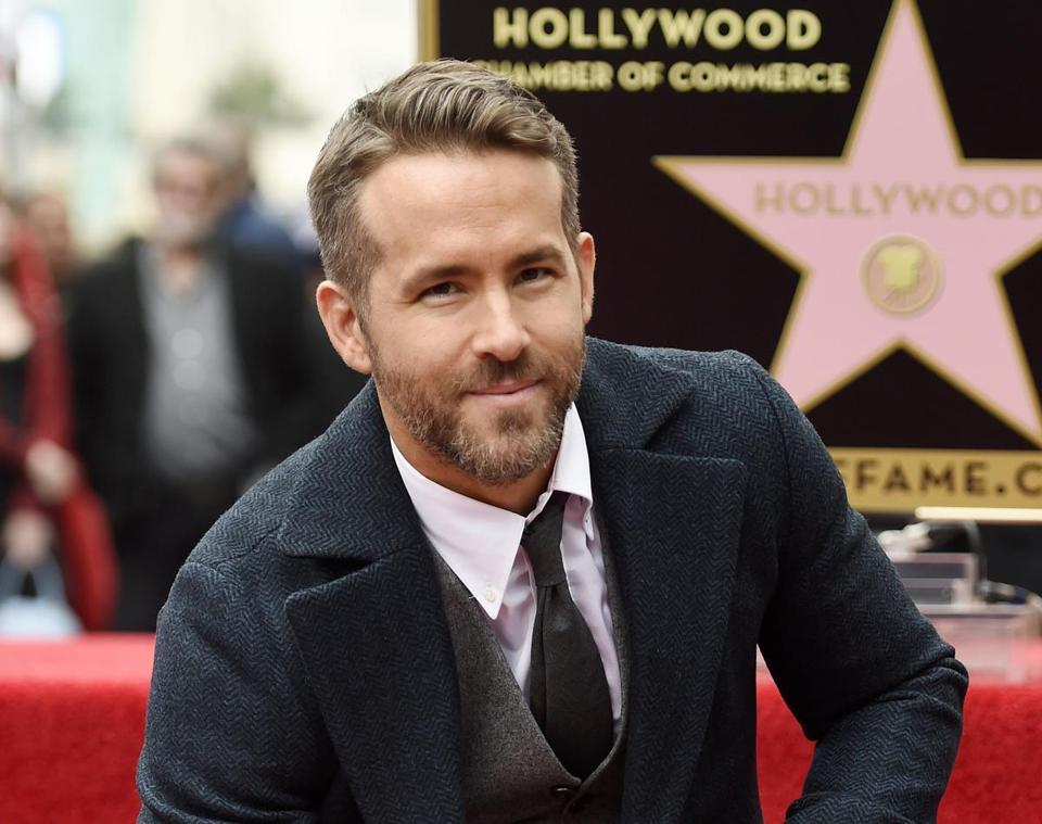 "FILE - In this Dec. 15, 2016 file photo, actor Ryan Reynolds poses at a ceremony honoring him with a star on the Hollywood Walk of Fame in Los Angeles. Reynolds has been named Man of the Year by Harvard University's Hasty Pudding student theatrical group. The actor who played the title role in 2016's ""Deadpool"" will be roasted by the student group before being getting his pudding pot on Feb. 3. (Photo by Chris Pizzello/Invision/AP, File)"