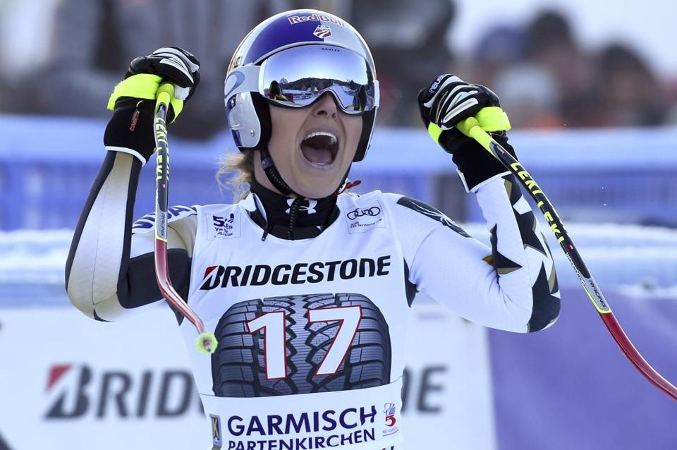 United States' Lindsey Vonn celebrates after completing an alpine ski, women's World Cup downhill, in Garmisch-Panterkirchen, Germany, Saturday, Jan. 21, 2017. (AP Photo/Marco Tacca)