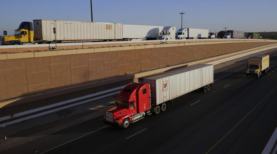 Trucks move along Interstate 35 in Laredo, Texas, in November. President Donald Trump's campaign promise to abandon the North American Free Trade Agreement helped win over Rust Belt voters who felt left behind by globalization.