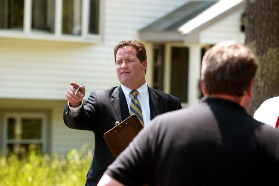 Dan Flynn took bids from prospective buyers during a foreclosure auction in Halifax.