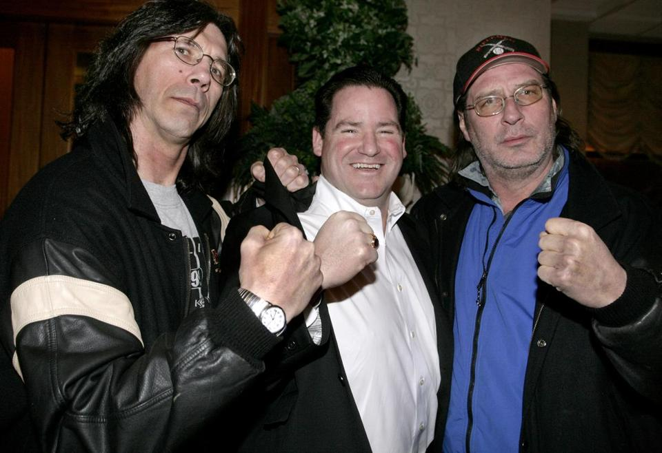 Dan Flynn (center) posed with former hockey players Steve Carlson (left) and Jeff Carlson (right) at the Boston Black and Gold Legends reception and auction benefit in Dorchester in 2007. The Carlson brothers played the two-thirds of the Hanson Brothers in the 1977 film 'Slap Shot.'