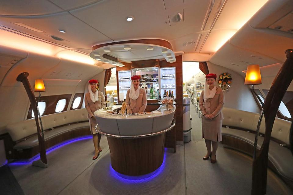 The upper lounge area of the Emirates A380 plane which visited Logan Airport that includes private suits, a shower spa, and a onboard lounge.