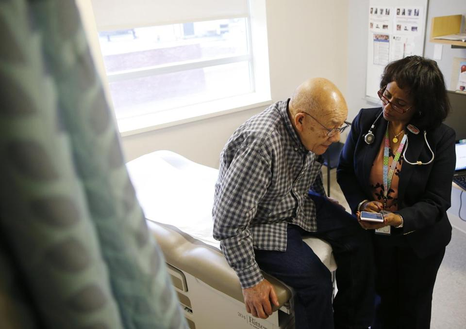 Lynn, MA -- 1/26/2017 - Frias Radhame, 76, of Lynn who is being treated for Tuberculosis at Lynn Community Health Center talks with Dr. Hanna H. Haptu during a visit. (Jessica Rinaldi/Globe Staff) Topic: 31TB Reporter: Felice Freyer