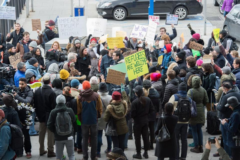 Protesters gather at JFK International Airport's Terminal 4 to demonstrate against US President Donald Trump's executive order, on January 28, 2016 in New York. Trump has signed a sweeping executive order to suspend refugee arrivals and impose tough controls on travellers from Iran, Iraq, Libya, Somalia, Sudan, Syria and Yemen. / AFP PHOTO / Bryan R. SmithBRYAN R. SMITH/AFP/Getty Images