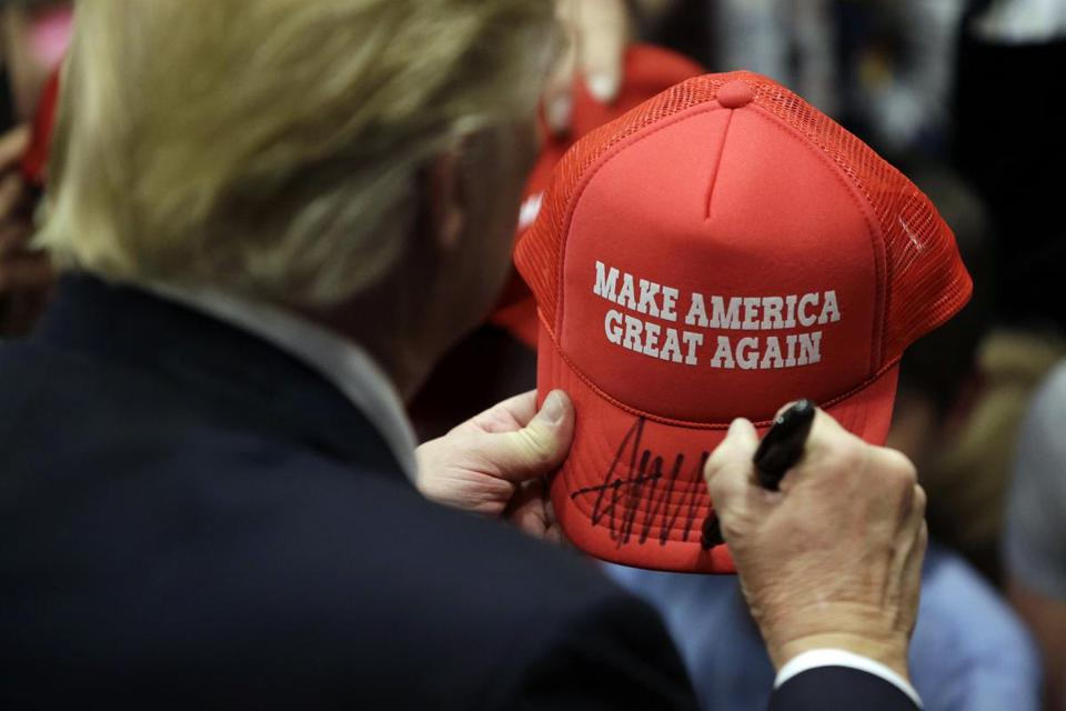 Republican presidential candidate Donald Trump signs an autograph for a supporter after speaking at a campaign rally at West Chester University, Monday, April 25, 2016, in West Chester, Pa. (AP Photo/Matt Slocum)