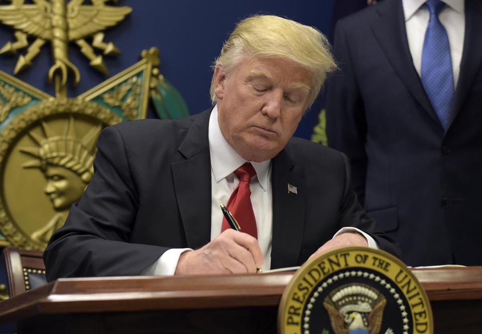 President Donald Trump signed an executive order severely limiting immigration from seven Muslim-majority nations on Friday.