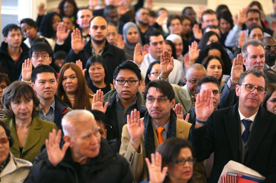Close to 350 people were sworn in as US citizens during a ceremony at Faneuil Hall.