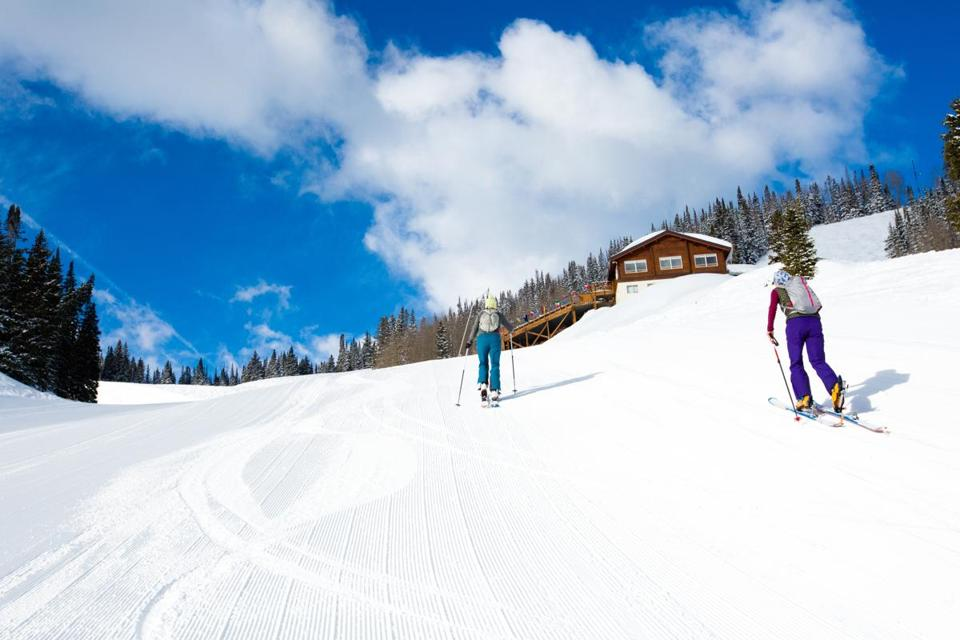 Skiers near a lodge in Colorado.