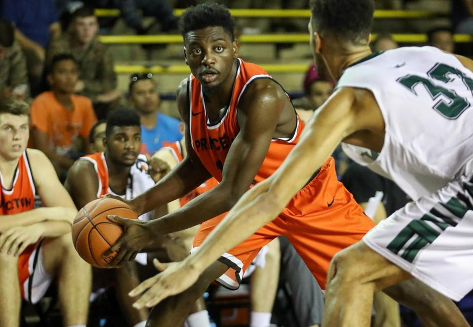 PEARL HARBOR, HI - DECEMBER 07: Myles Stephens #12 of the Princeton Tigers is guarded by Noah Allen #32 of the Hawaii Rainbow Warriors during the second half of the Pearl Harbor Invitational NCAA college basketball game at Bloch Arena on December 7, 2016 in Pearl Harbor, Hawaii. Princeton over Hawaii 75-62. (Photo by Darryl Oumi/Getty Images)