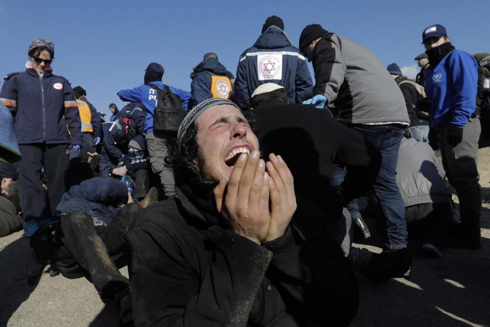 Israeli police evict settlers from the West Bank outpost of Amona on Feb. 2.