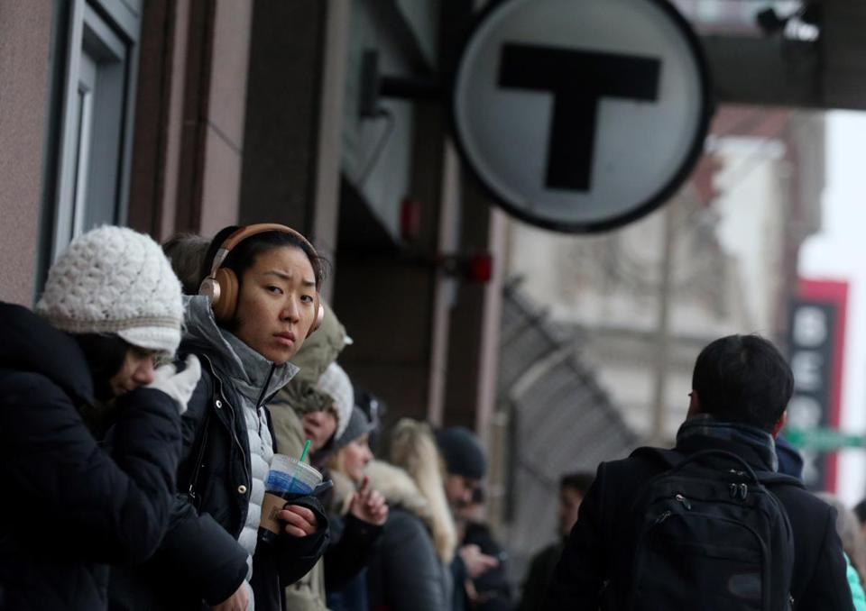 Boston, MA- February 08, 2017: Jeanie Chung waits for her bus on Mass Ave. during the morning commute in Boston, MA on February 08, 2017. She said the bus was already 25 minutes late and she was going to be late for work. (Globe staff photo / Craig F. Walker) section: metro reporter: