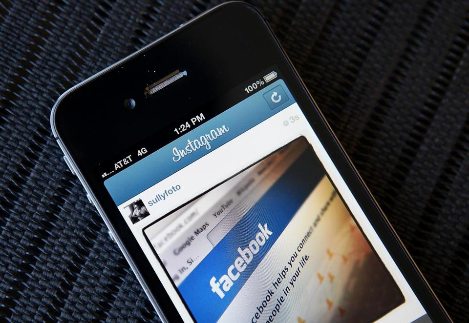 FILE - FEBRUARY 01: Facebook reported fourth-quarter higher earnings and sales of $3.56 billion, beating analysts growth expectations. NEW YORK, NY - APRIL 09: In this photo illustration, an Instagram photo of the Facebook website app is seen on an Apple iPhone on April 9, 2012 in New York City. Facebook Inc. is acquiring photo-sharing app Instagram for approx. $1 billion. (Photo illustration by Justin Sullivan/Getty Images)
