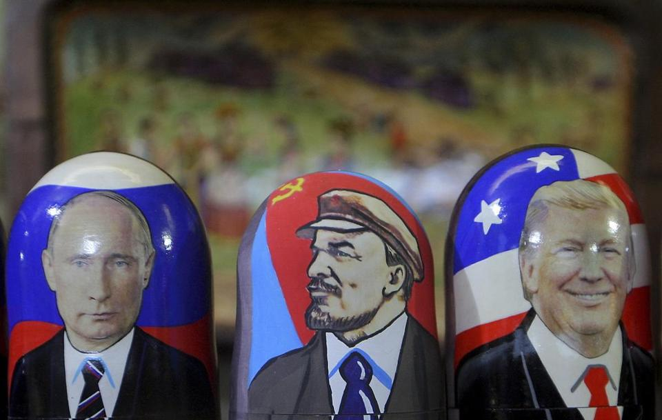 Traditional Russian wooden matryoshka doll with a picture of President-elect Donald Trump (right), Vladimir Lenin, a Soviet politician and statesman (center) and Russian President Vladimir Putin (left) at the fair on the Red Square in Moscow. Russia, Friday, January 6, 2017. (Photo by Danil Shamkin/NurPhoto) *** Please Use Credit from Credit Field ***(Sipa via AP Images)