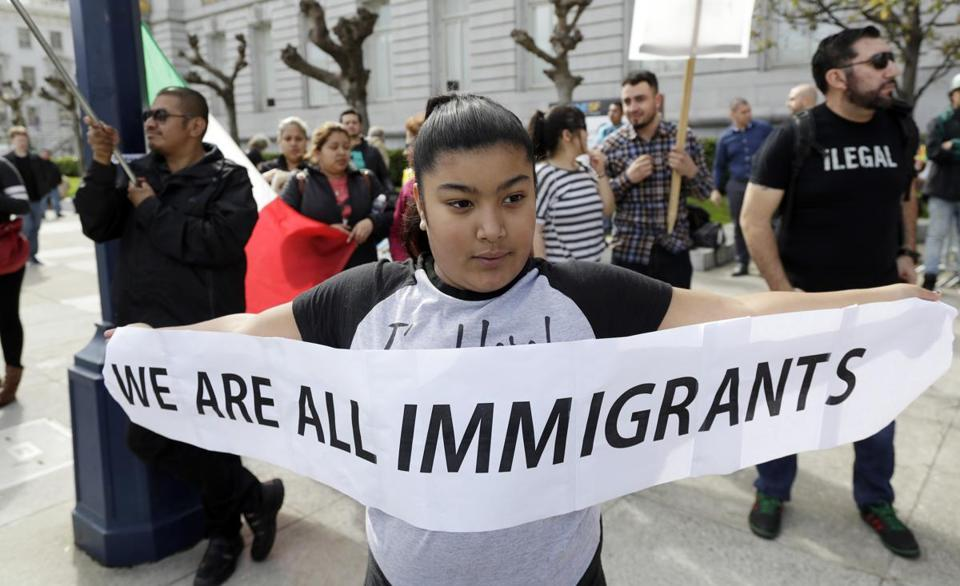 Delilah Gutierrez, 10, left, holds a sign during a protest against President Donald Trump's efforts to crack down on immigrationThursday, Feb. 16, 2017, in San Francisco. Immigrants around the country have been staying home from work and school today, hoping to demonstrate their importance to America's economy and its way of life. (AP Photo/Marcio Jose Sanchez)