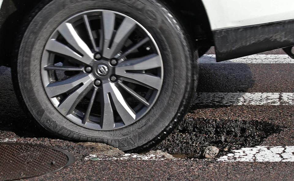 BOSTON, MA - 2/16/2017: A deep one on Ruggles Street near the NU campus...Pot Hole season making a comeback throughout the Boston area despite being filled in. (David L Ryan/Globe Staff Photo) SECTION: METRO TOPIC 16potholes