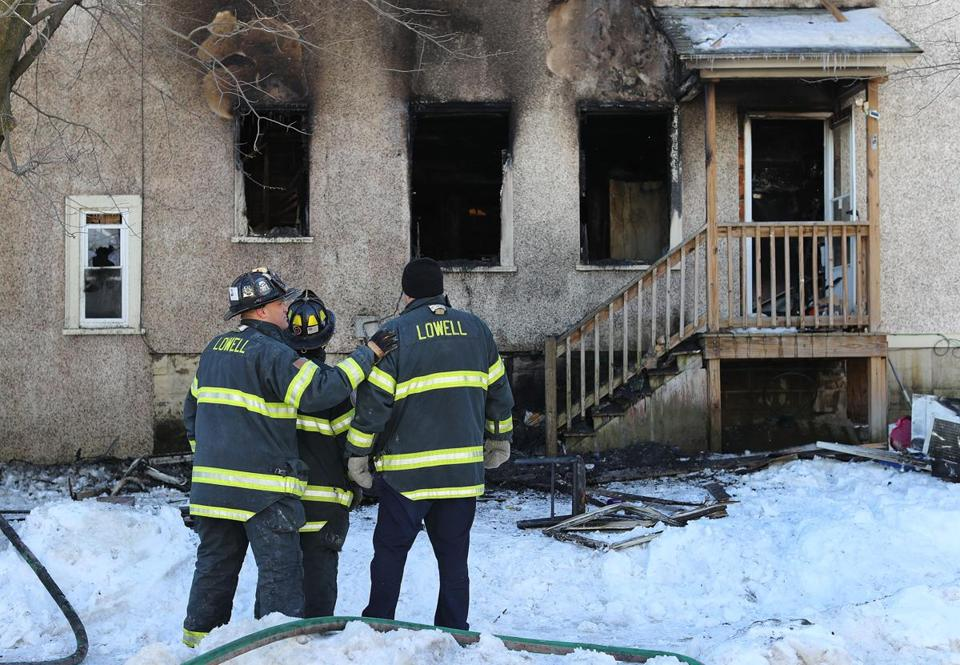 Firefighters worked at the scene of a fatal three-alarm fire in Lowell.