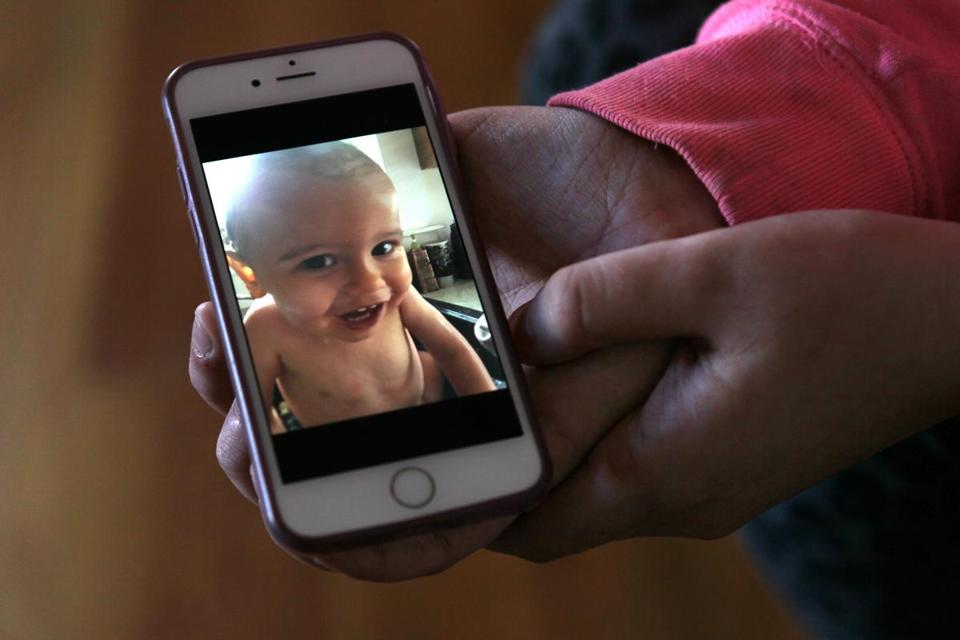 Feb 17, 2017_ WOBURN -- Lindsey Keane, of Woburn, show a cell phone photo of her toddler son Noah who died after trauatic head injuries that she is convinced was inflicted by the babysitter. (Joanne Rathe/ Globe Staff topic: section : metro )