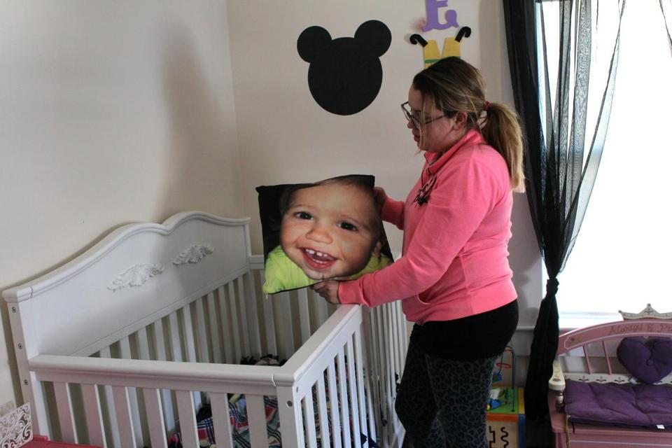 Lindsey Keane held a pillow with the photo of her son, Noah.