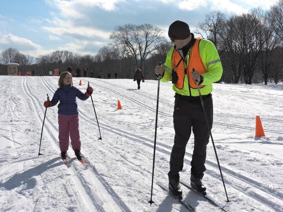 26zorec - Andy Cracknell teaching Anna Burtnet at the Leo J. Martin Ski Track in Weston. (Department of Conservation and Recreation)