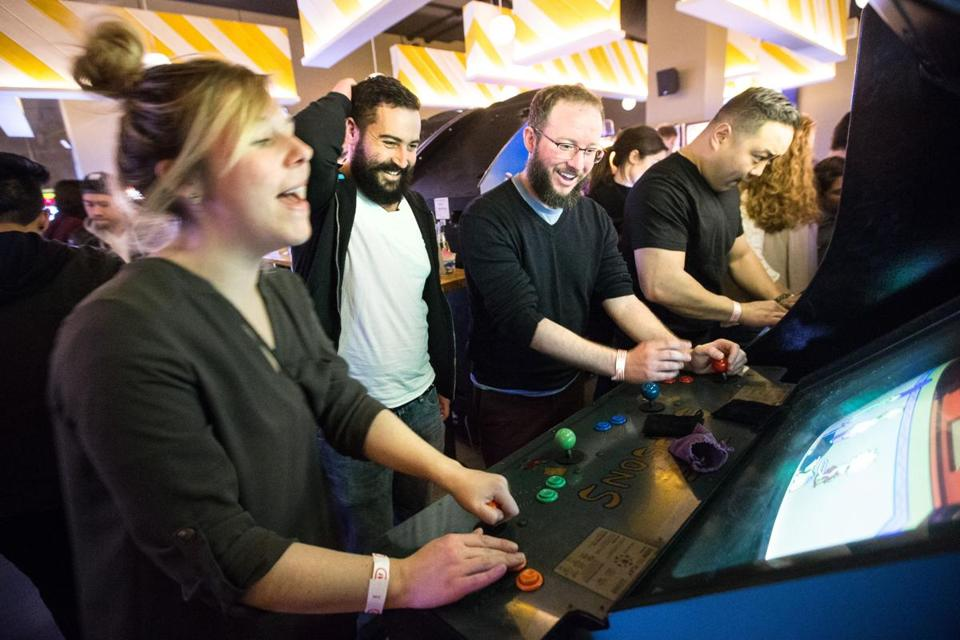 From left: Kara Brooks, JM Craven, and Cliff Ashbrook play video games at Roxy's Central & A4cade.