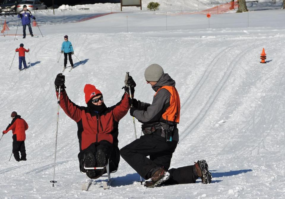 26zorec - Sitskier Thomas Dodd is guided by Will Morgan at the Leo J. Martin Ski Track in Weston. (Department of Conservation and Recreation)