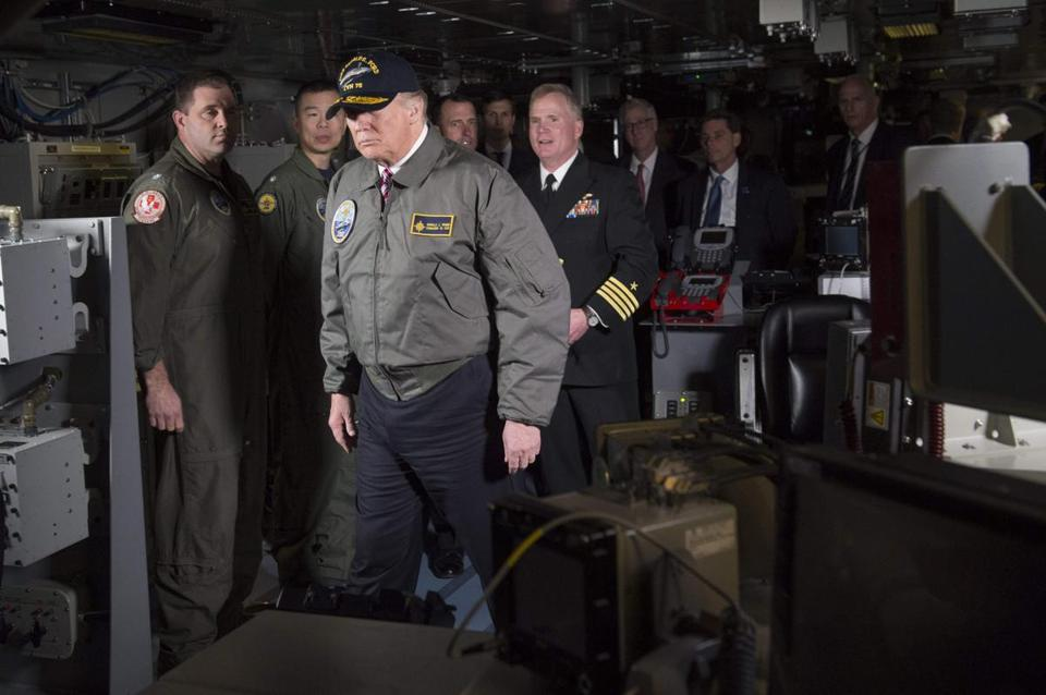 US President Donald Trump tours the Combat Direction Center on the pre-commissioned USS Gerald R. Ford aircraft carrier in Newport News, Virginia on March 2, 2017. / AFP PHOTO / SAUL LOEBSAUL LOEB/AFP/Getty Images