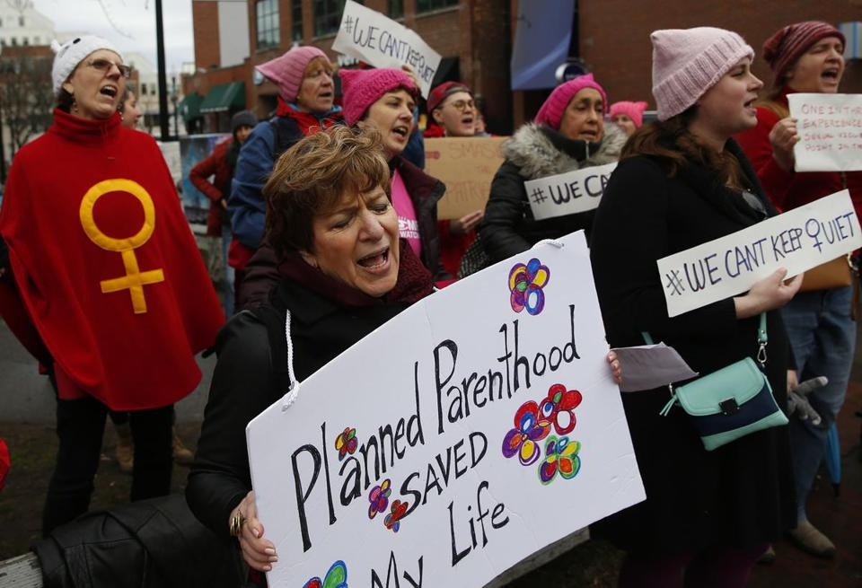 Jean Trounstine of Tewksbury held a sign supporting Planned Parenthood.