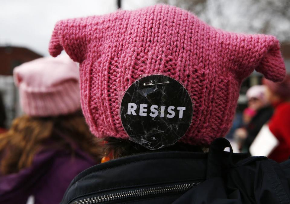 "A ""resist"" button was seen on the back of a hat."