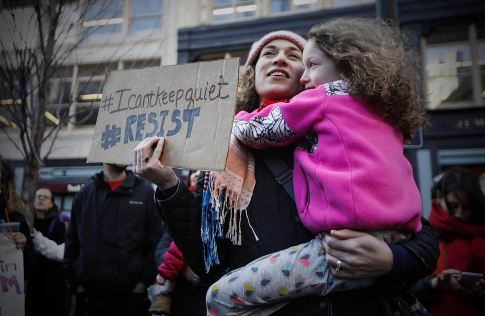 Jennifer Jones held her daughter during the Downtown Crossing rally.