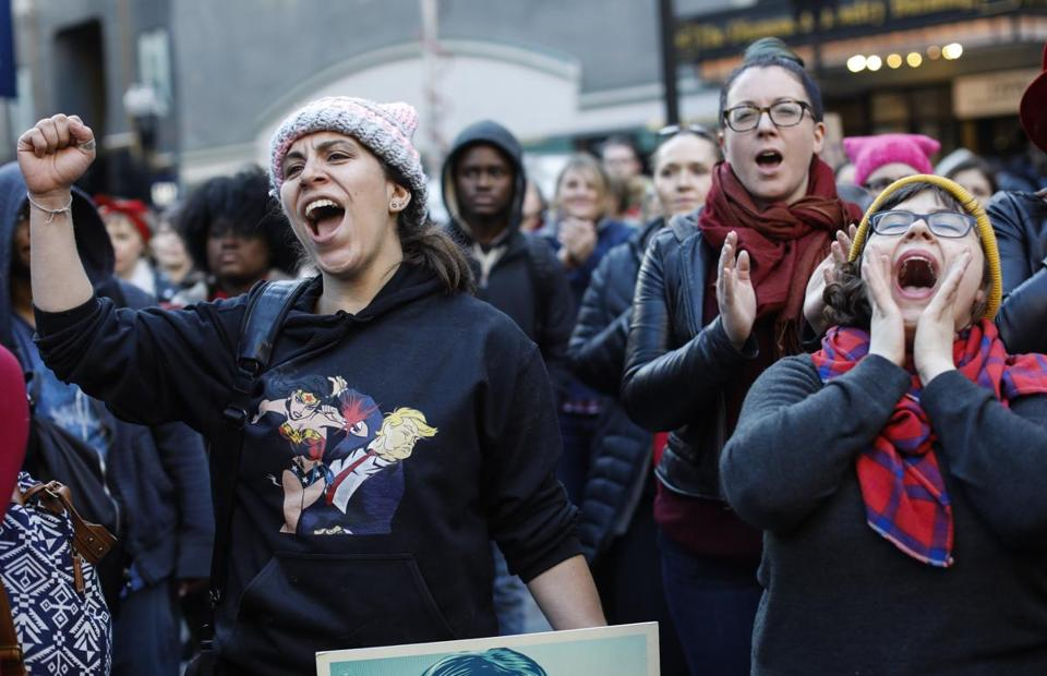 Women cheered during the Downtown Crossing rally.