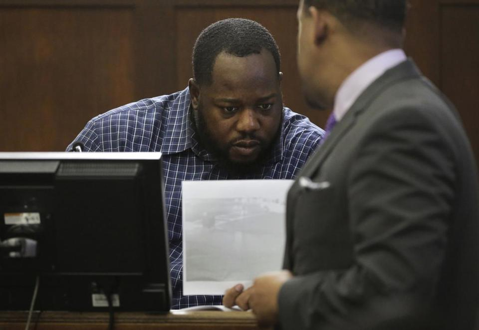 Ugochukwu Ojimba (center) was shown a photograph by defense attorney Ronald Sullivan (right) during the double murder trial of former New England Patriots tight end Aaron Hernandez.