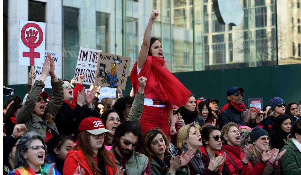 Women participate in a protest on 5th Avenue near Trump Tower in New York March 8, 2017 during a #DayWithoutAWoman protest in New York. / AFP PHOTO / TIMOTHY A. CLARYTIMOTHY A. CLARY/AFP/Getty Images