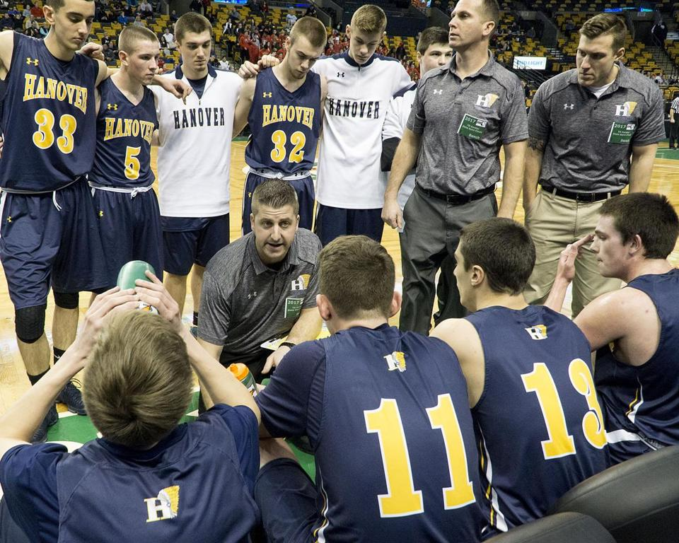 8.3.1878343051_Sports_14gardenhoop Hanover head basketball coach Nick Hannigan talks to his players in a time out during the MIAA Div. 3 boys semi-finals basketball game against Watertown won by Hanover 46-40 at TD Garden in Boston, Monday, March 13, 2017. (Robert E. Klein for the Boston Globe)