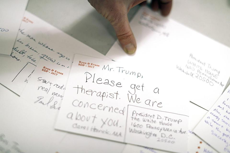 Postcards addressed to President Trump were sorted at First Parish Watertown. The cards will be mailed en masse Wednesday.