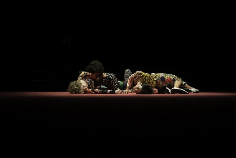 "Dancers lie on the floor in a scene from a ""STAGED?"" performance."