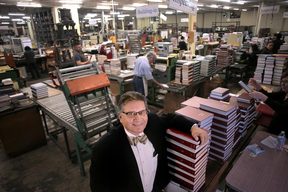 Charlestown, MA - 03/16/17 - Parisi on the bindery floor. Paul Parisi (cq) is president and COO of HF Group. He runs Acme Bookbinding, a second-generation binder, and he grew up in a small family-owned shop. Acme has grown from a one-person basement operation to a 150-employee company in a modern 100,000 square-foot facility with world class systems and machinery. They bind everything from single run copies to hundreds of thousands of books. Acme traces its beginnings back to 1821 via an acquired company, and is thus the oldest continuously operated book bindery in the world. (Lane Turner/Globe Staff) Reporter: (Cindy Atoji Keene) Topic: (03onthejob)