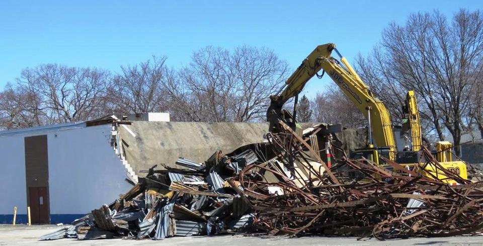 The demolition of Building 19 1/2 in Burlington began on March 13 and is expected to take a month to complete (photo by George Weinstein for The Boston Globe)