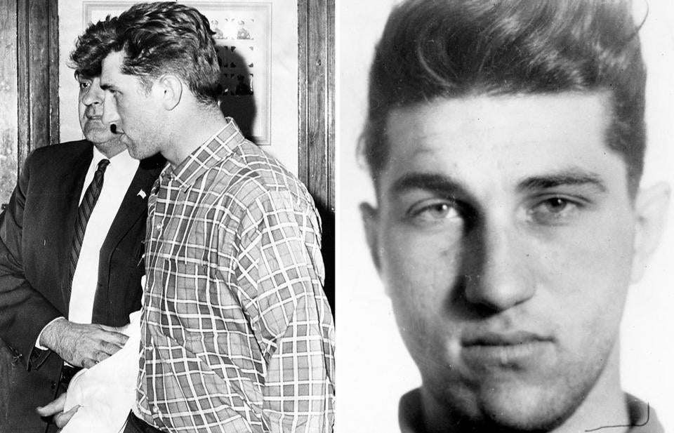 Richard Steeves was escorted in the Rochester, N.H., police station on Jan. 5, 1966. He was wanted in connection with five separate murders in the three states.