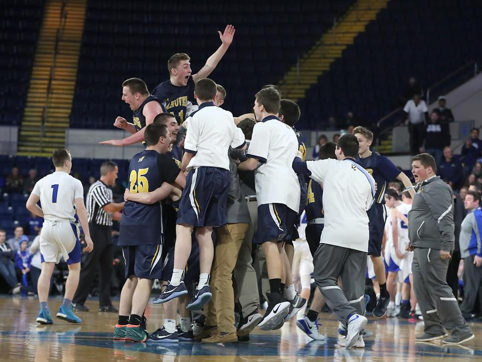 Springfield MA 3/18/17 Hanover High School Indians players celebrate their 58-43 victory over Palmer High Panthers winning the 2017 Boys Division 3 MIAA State Finals at MassMutual Center. (Photo by Matthew J. Lee/Globe staff) topic: reporter: