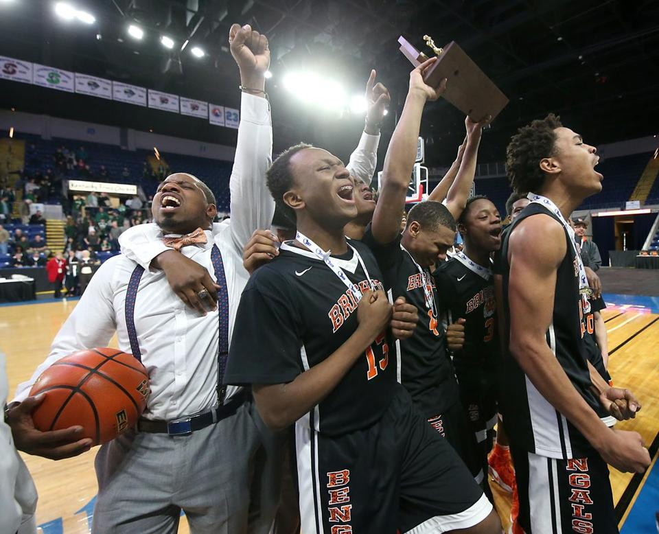 Springfield MA 3/18/17 Brighton High School Bengals head coach Hugh Coleman and his players celebrate after they defeated Nashoba High Chieftains 82-58 during the 2017 MIAA Boys Division 2 State Finals at MassMutual Center. (Photo by Matthew J. Lee/Globe staff) topic: reporter:
