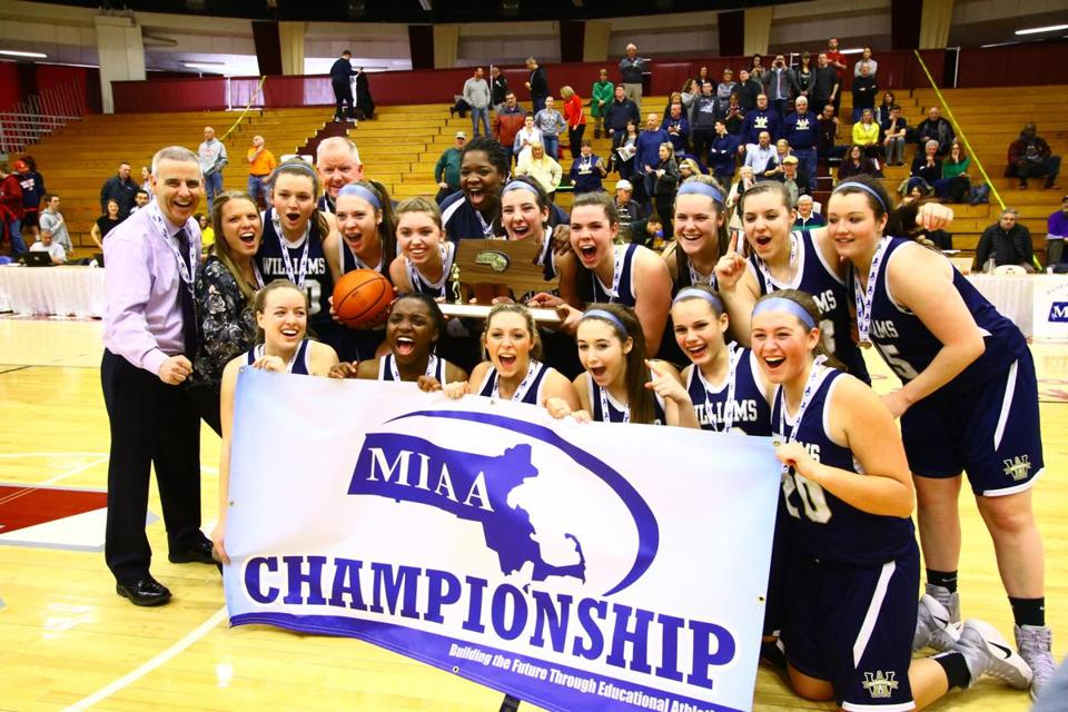 Archbishop Williams players celebrate with their coach, and assistants after defeating Hoosac Valley in the Division 3 State Championship game at Blake Arena, Springfield College, on Saturday, March 18, 2017. Mark Lorenz for The Boston Globe