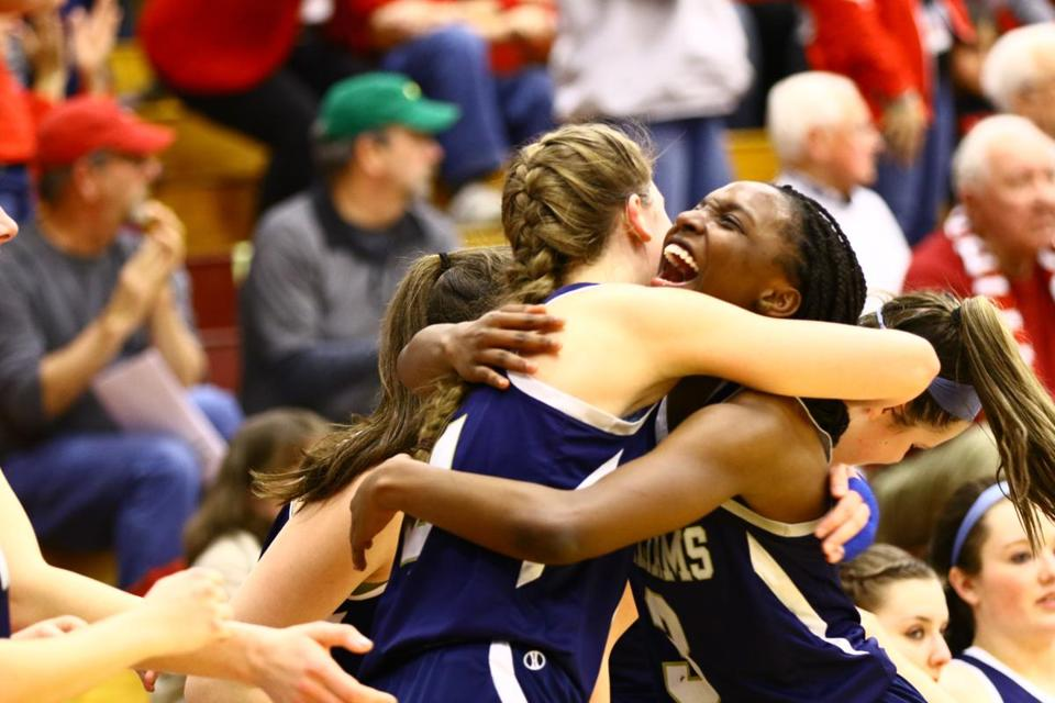 Archbishop Williams players, Meagan Donovan and Asiah Dingle celebrate with seconds left in the fourth period, taking the Division 3 State Championship trophy home, after defeating Hoosac Valley, at Blake Arena, Springfield College, on Saturday, March 18, 2017. Mark Lorenz for The Boston Globe