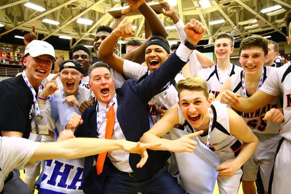 Maynard coach Paul Howes and his players celebrate their Division 4 win over St. Mary's of Lynn, in the state championship game at Blake Arena, Springfield College, on Saturday, March 18, 2017. Mark Lorenz for The Boston Globe