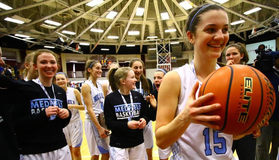 Margaret McCarthy received the game winning ball, after she scored her 1000th score, during the Division 2 State Championship game at Blake Arena, Springfield College, on Saturday, March 18, 2017. Mark Lorenz for The Boston Globe