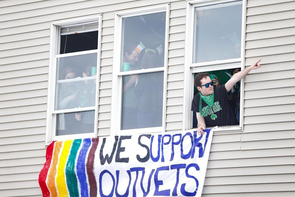 People in support of OUTVETS cheered from their window.